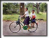 Ankor Wat, schoolgirls, bicycle, Cambodia, travel photography, photography, art prints, posters, post cards